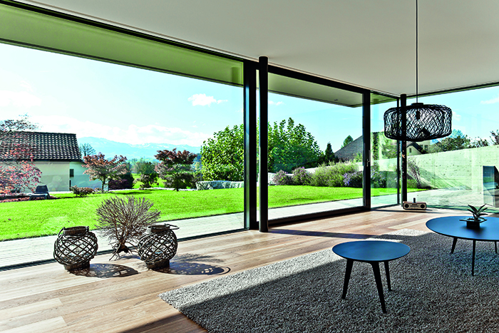 Sliding patio doors help bring the garden into this cool Swiss home