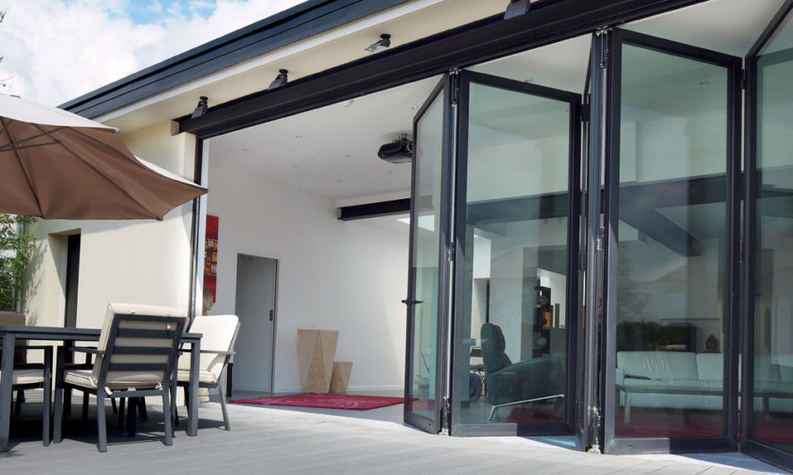 Folding patio doors turn a courtyard into outdoor living space