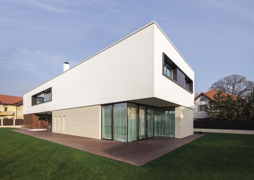 Windows and doors seamlessly link this sleek, modern home to its garden