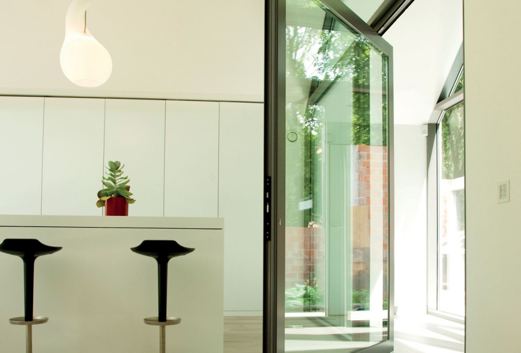 Pivoting aluminium doors can help fill your home with light this summer