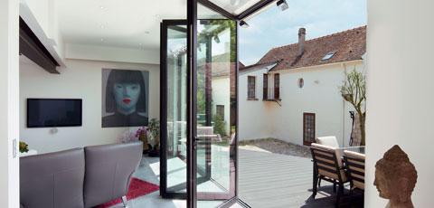 Aluminium bifold doors help you make the most of the garden in summer