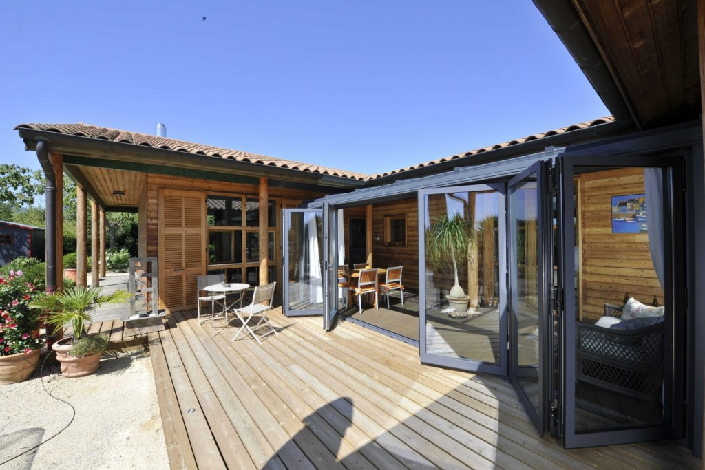 Sliding folding doors make this stunning French home