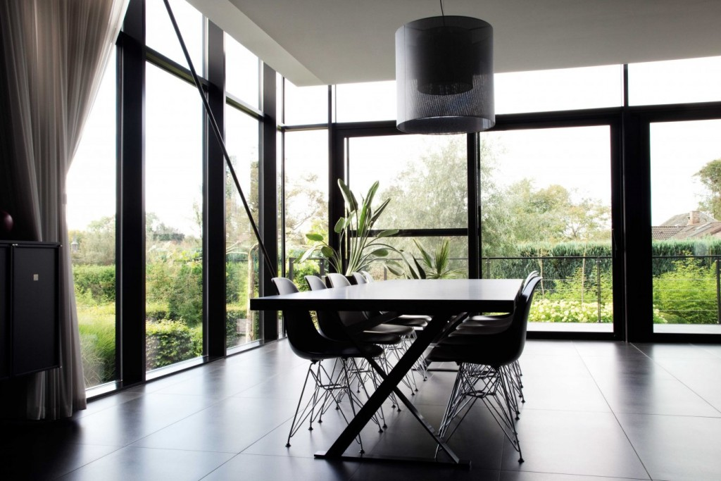 Windows and doors make this chic, contemporary Belgian home