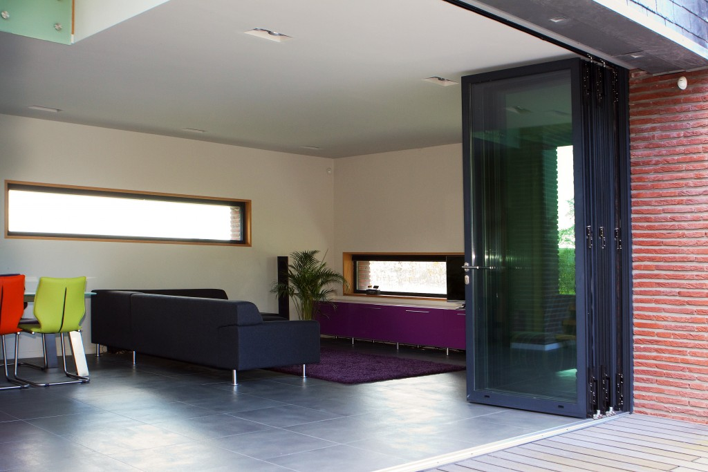 Sliding folding doors help make the perfect family room