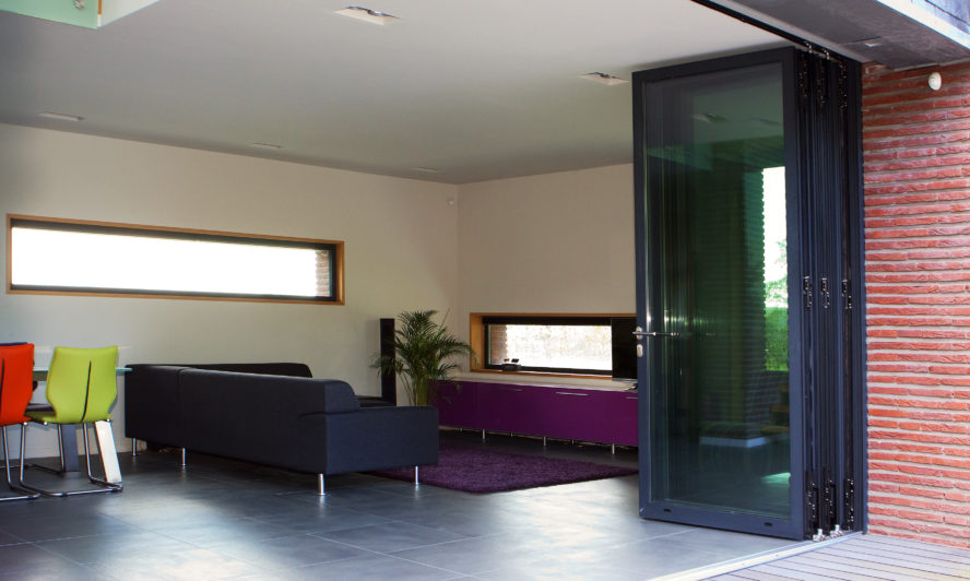 Extending into the loft? Why not maximise your light and views with sliding folding doors?