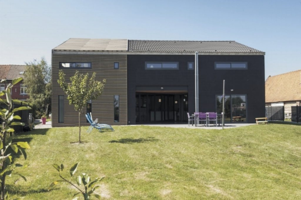 Sliding folding doors complete this timber-clad home