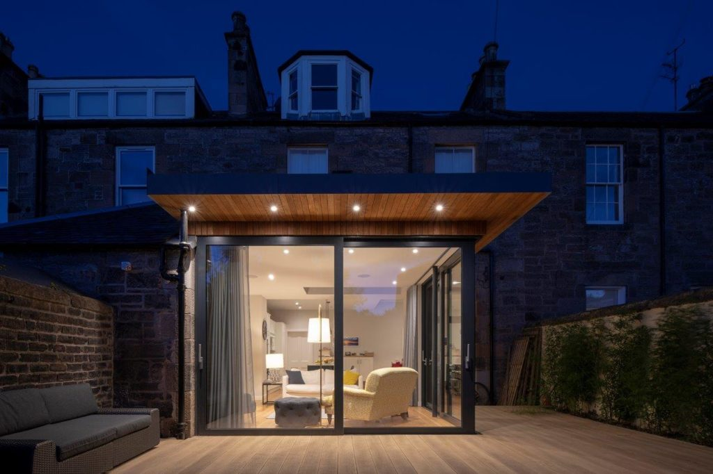 beautiful patio at night with sliding doors