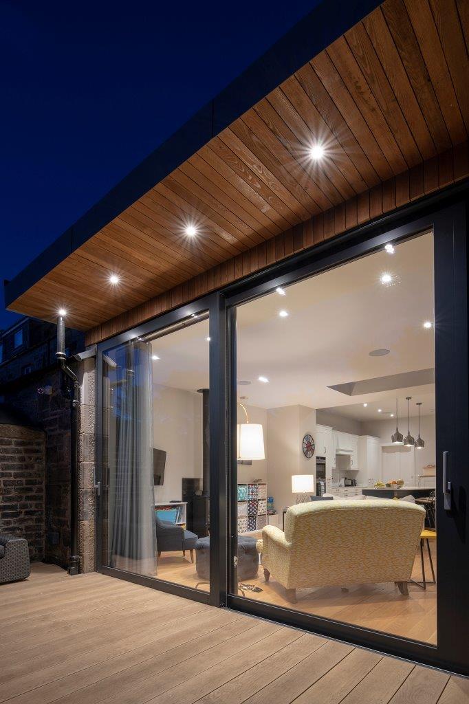 close up of beautiful patio doors at night with sliding doors